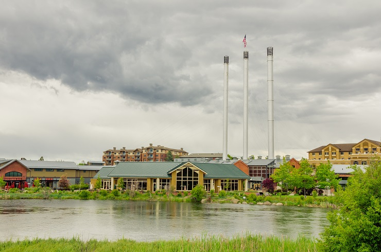 Old Mill District in Bend, along the river with brewery stacks in background.